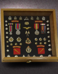 16x16x2.5-red-oak-shadow-box-with-Malaysian-Military-awards