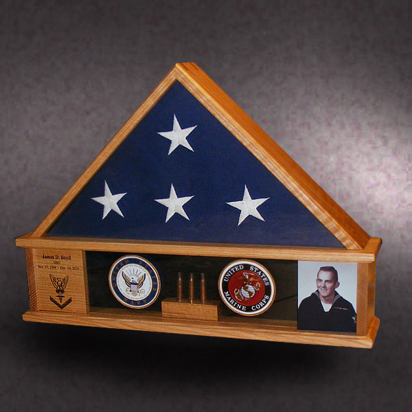 custom red oak shadow box with shell casings and medalions